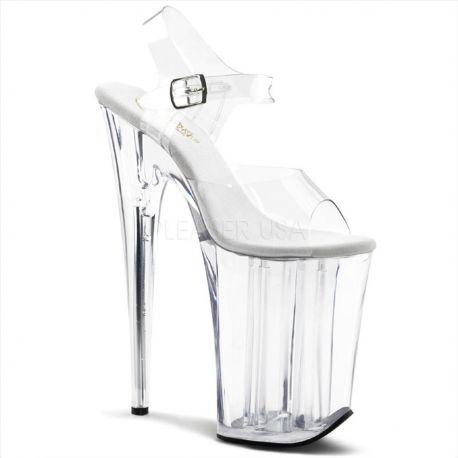 Sandalia de plataforma extra alta transparente y correa al tobillo